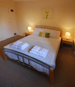 Photo of bedroom of Clover Holidays' Leslie House self-catering accommodation